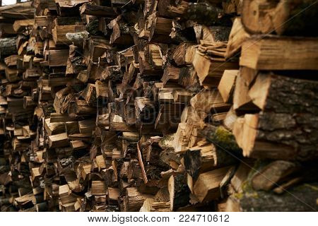 Close-up of a firewood pile. Preparation of firewood for the winter and use for cooking, firewood background, Stacks of firewood in the village