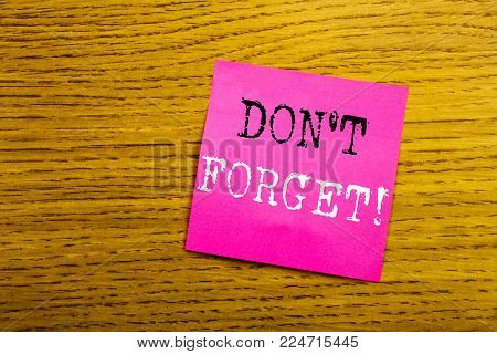 Handwriting Announcement text showing Do Not Forget. Business concept for Reminder Message written on sticky note empty paper, background with copy space, sunglasses.