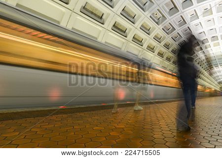 A train in motion as seen in a Metro Station  - Washington DC  - United States