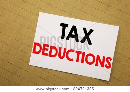 Conceptual hand writing text caption inspiration showing Tax Deductions. Business concept for Finance Incoming Tax Money Deduction Written on sticky note yellow background