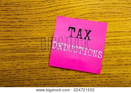 Handwriting Announcement text showing Tax Deductions. Business concept for Finance Incoming Tax Money Deduction written on sticky note empty paper, background with copy space, sunglasses.