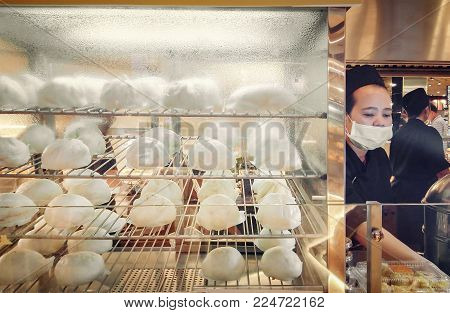 BANGKOK, THAILAND - JANUARY 03: Food court in The Mall Bangkhae serves Chinese styled steamed buns in Bangkok on January 03, 2018.
