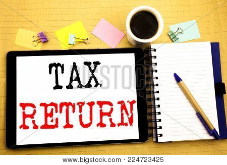 Tax Return. Business concept for Accounting Money Return Written on tablet, wooden background with sticky note and pen
