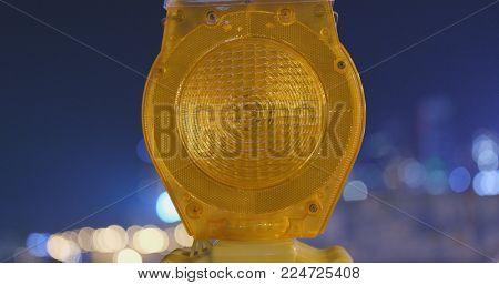 Caution yellow light at night