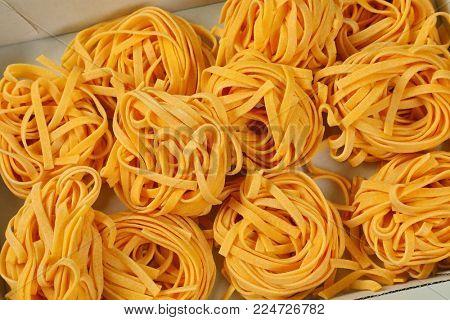 box of dried ribbon pasta bundles - close up
