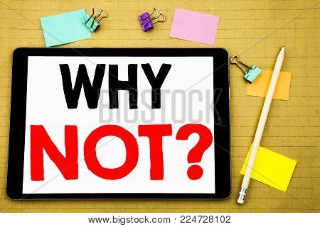 Hand writing text caption inspiration showing Why Not Question. Business concept for Leadership Motivation Written on tablet, wooden background with sticky note and pen