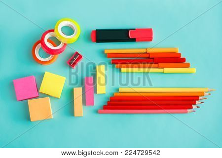 top view portrait of colorful office stationary on pastel background