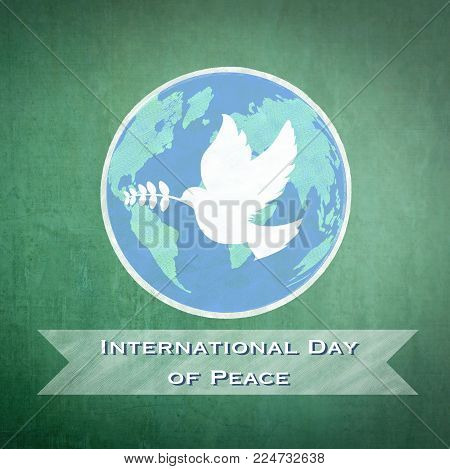 International day of peace message of world peace day campaign with white dove and olive branch drawing on green chalkboard background