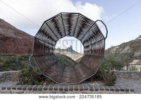 Roque Bentayga seen through a braided basket in Tejeda, Gran Canaria, Spain