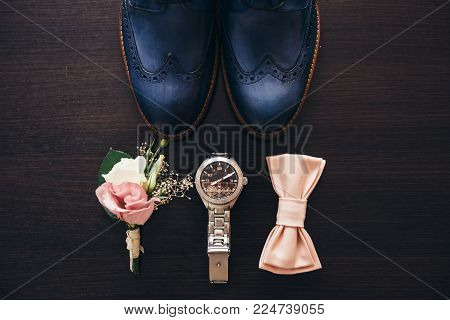 Stylish Men's Shoes On A Dark Wooden Table