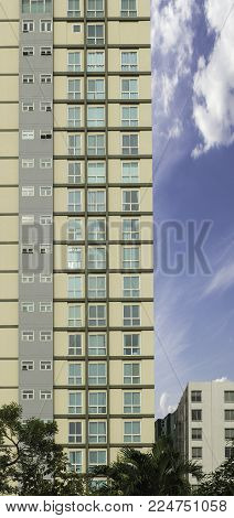 high rise apartment building on blue sky