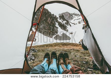 Travel couple feet mountains view from tent camping entrance Lifestyle concept adventure vacations outdoor