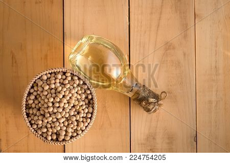 Soy Bean And Soy Oil On A Wooden Table