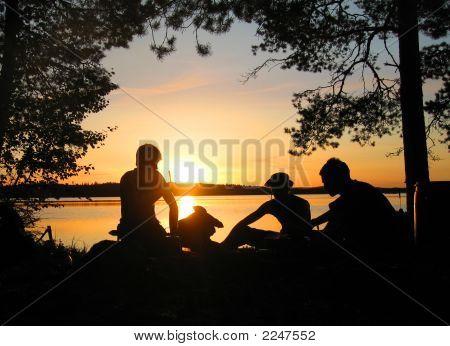Three Men At A Campfire