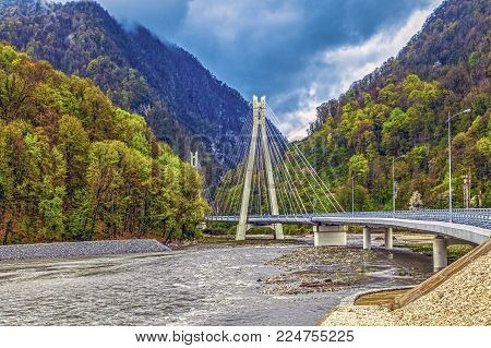 SOCHI, RUSSIA - APRIL 20, 2015: the bridge over the river Mzymta in Red Glade