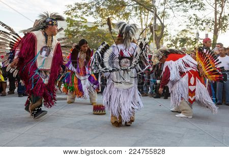 SAN SALVADOR, EL SALVADOR - JANUARY 5: Native American dancers show their traditional dances on the central square of San Salvador on January 5, 2018 in El Salvador.