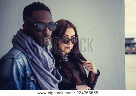 Portrait of afro american guy with caucasian female in sunglasses.