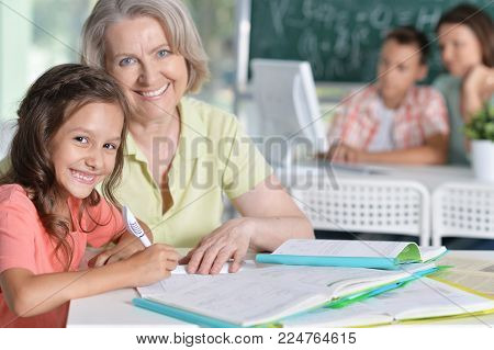 Teachers working with pupils in computer class