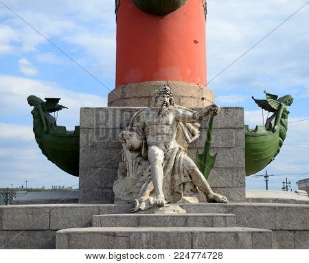 Statue at pedestal of Rostral Column in St.Petersburg, Russia.
