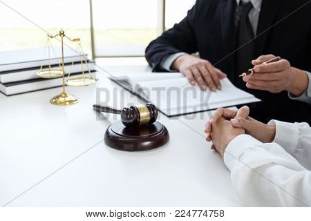 Close Up Of Gavel, Male Lawyer Or Judge Consult With Client And Working With Law Book, Report The Ca