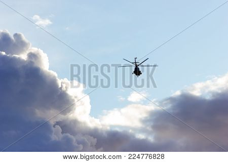 Summer cityscape with helicopter mi 8 in Saint-Petersburg at golden hour, view from arsenal embankment