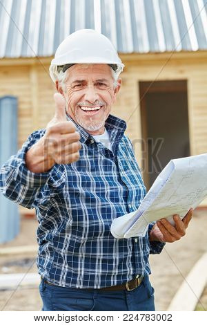 Successful senior citizen as craftsman holding thumbs up