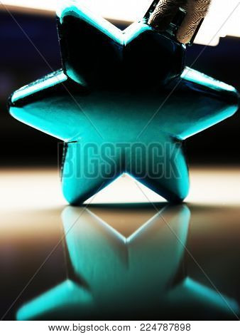 Blue chrismas ornament of star shape close up new year background