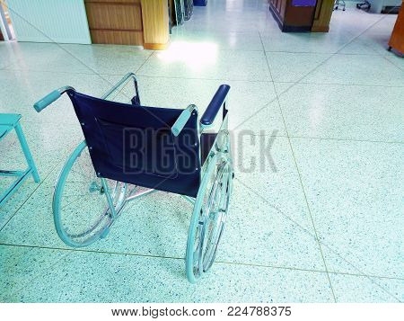 Empty wheelchair resting in the lobby of a hospital. healthcare and disability image