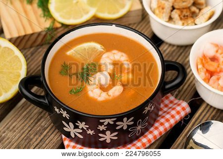 French traditional fish soup bisque with lobster, langoustine and shrimps