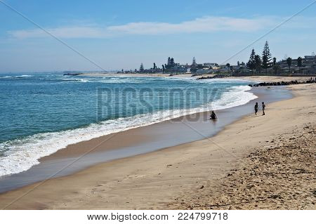Swakopmund, Namibia - Jan 31, 2016: Public beach on the ocean shore in Swakopmund. Swakopmund was founded in 1892, by Captain Curt von Francois as the main harbour of German South West Africa