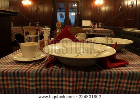 Emptied dinner table after meal in retaurant