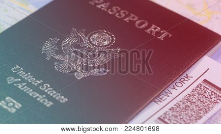 American citizen passport and a flight ticket for a travel