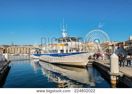 Marseille, France - December 4, 2016: The passenger ferry-boat Henri Jacques Esperandieu in the old Vieux port in Marseille, Provence, France.