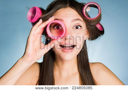 a bewildered woman with big curlers on her head