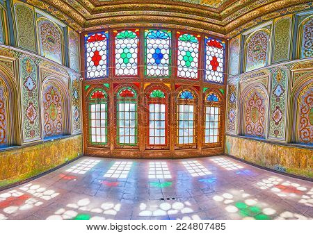 Shiraz, Iran - October 12, 2017: The Colored Stained Glass Windows Are Reflected On The Floor Of The