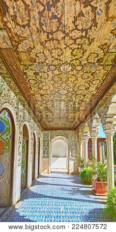 Shiraz, Iran - October 12, 2017: The Covered Galley Of Zinat Ol-molk Complex With Paintings On Woode
