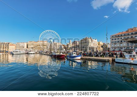 Marseille, France - December 4, 2016: Sunday ambiance at the Old Vieux Port in Marseille, France. It is a busy port, used as a marina and as a terminal for boat trips, and hosts a fish market.
