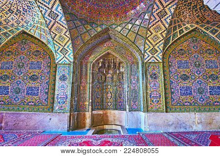 Shiraz, Iran - October 12, 2017: The Tiled Mihrab In Nasir Ol-molk Mosque With Fine Patterns And Muq