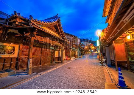 Kyoto, Japan - April 24, 2017: Ninenzaga street at dusk, Southern Higashiyama. Ninen-zaka, it is a pedestrian street with wooden houses, traditional shops and restaurant in Kyoto.