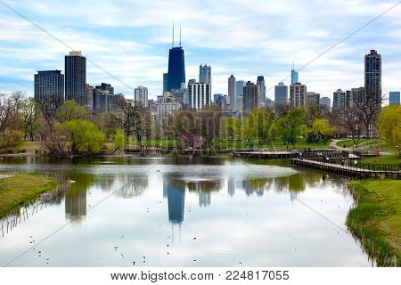 Chicago, Illinois, United States - May 07, 2011: Downtown skyline and South Pond at Lincoln Park.