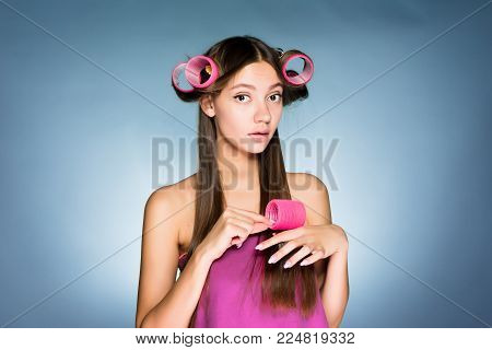 surprised woman with big curlers on her head