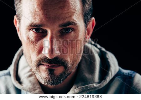 Image of serious strong man. Sad face expression.