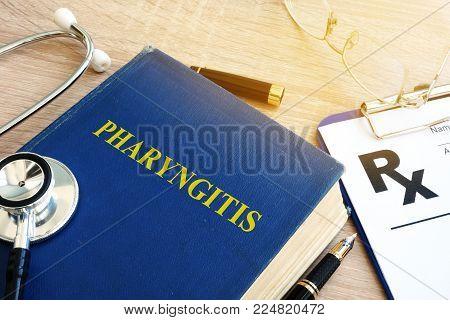 Book about pharyngitis on a hospital table.