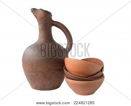 Georgian wine old clay jug with clay cup on white background, isolated