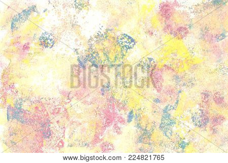 Pastel colour paints daubed abstractly on paper background