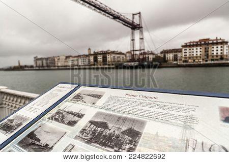 Portugalete,spain-january 10,2017:information Sign And Vizcaya Bridge, Puente Colgante View From Por