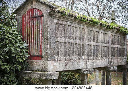 SANTIAGO DE COMPOSTELA,SPAIN-NOVEMBER 22,2017:Park, Parque Vista Alegre, Finca Simeon; Horreo, ancient construction, typical granary, Santiago de Compostela,Spain.