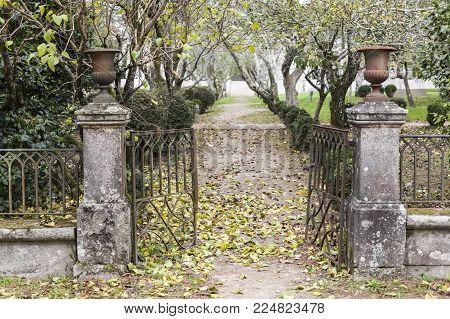 SANTIAGO DE COMPOSTELA,SPAIN-NOVEMBER 22,2017:Garden,ancient entrance iron gate,park,parque vista alegre.Santiago de Compostela,Spain.