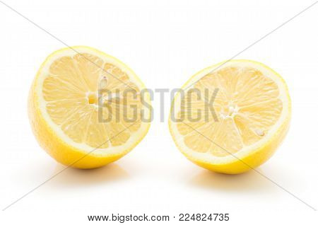 Two lemon halves isolated on white background one yellow lemon cut in half cross section