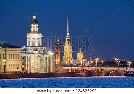 Saint-Petersburg, Russia. Evening view of illuminated sights - Kunstkamera, Rostral column, Peter and Paul Fortress